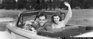 "Teenage couple in 1940s about to go ""necking""."