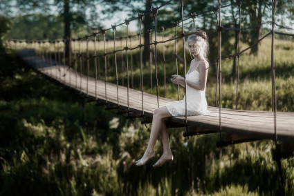 Gratuitous pic of girl with big feet  on suspension bridge.
