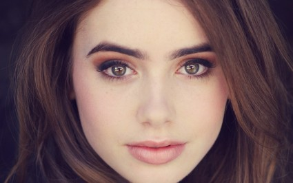 Lily Collins, heavily retouched, but still...
