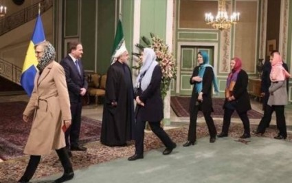 "Members of Sweden's ""feminist"" gov't wearing hijabs. Good girls."
