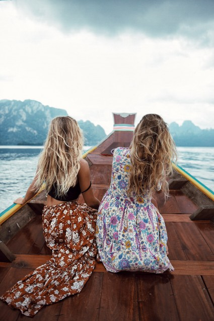 Summer dresses on Viking looking boat.