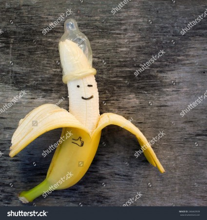 stock-photo-banana-with-condom-on-the-old-wooden-background-246463939