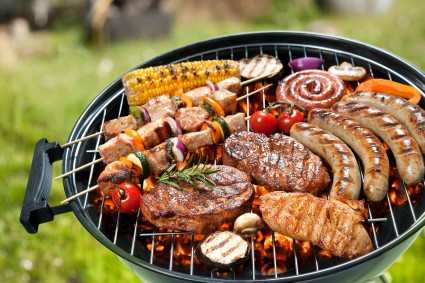 Assorted delicious grilled meat with vegetable over the coals on